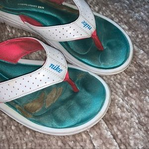 Well worn well used Nike sandals flats slip on